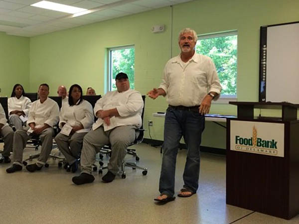 Restaurateur Matt Haley, speaking at the Food Bank of Delaware on Aug. 5.