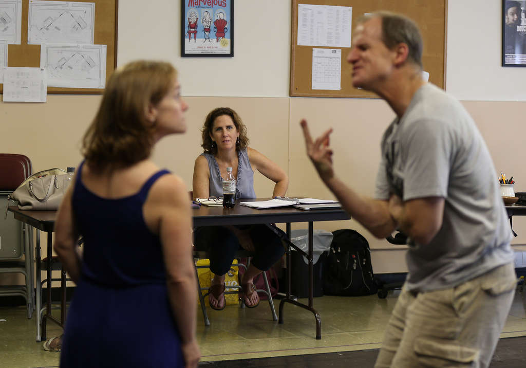 DAVID MAIALETTI / STAFF PHOTOGRAPHER Director Mary Carpenter observes as Jen Childs and Anthony Lawton rehearse.