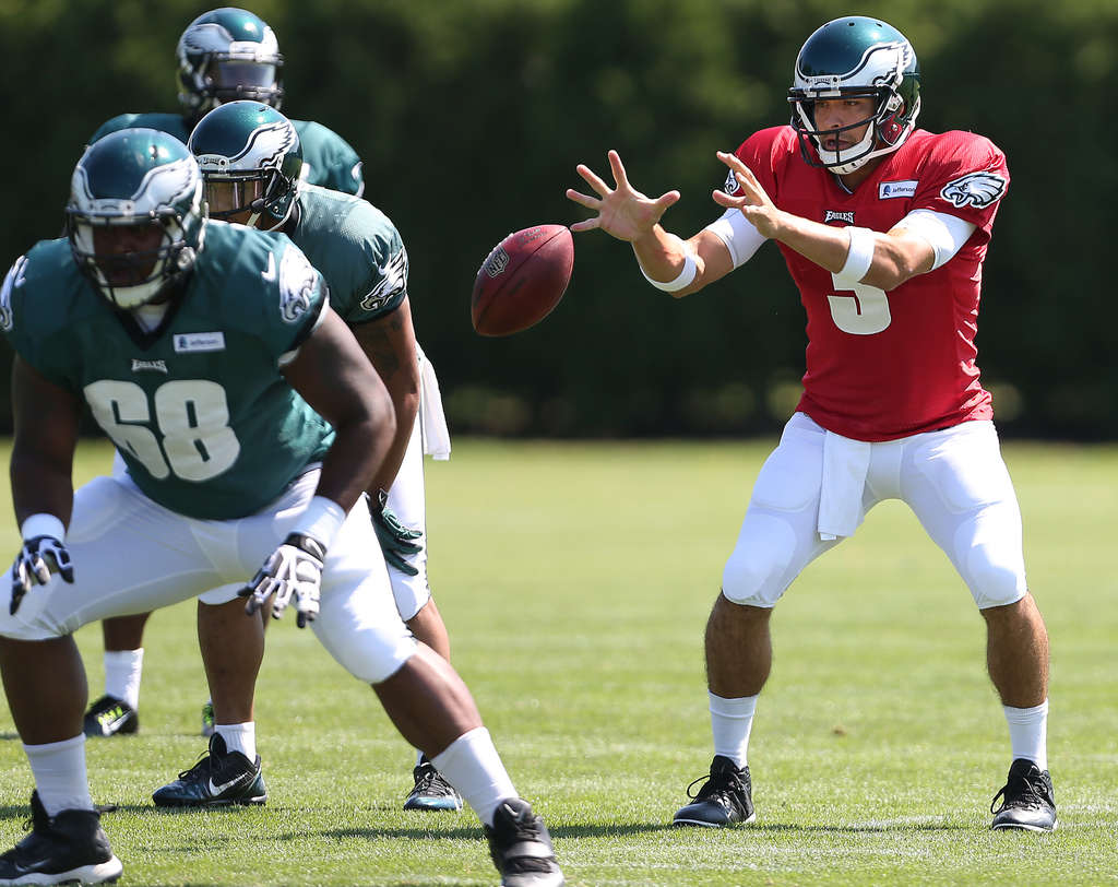 DAVID MAIALETTI / STAFF PHOTOGRAPHER Mark Sanchez, shown taking a snap during practice, said, ´I am an Eagle and I love being an Eagle.´