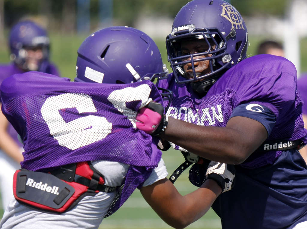 """""""When you just see the tools that he has, the upside is through the roof,"""" Roman Catholic coach Joe McCourt says of Manny Taylor (right), a senior lineman who is making his varsity debut.  LOU RABITO / Staff"""