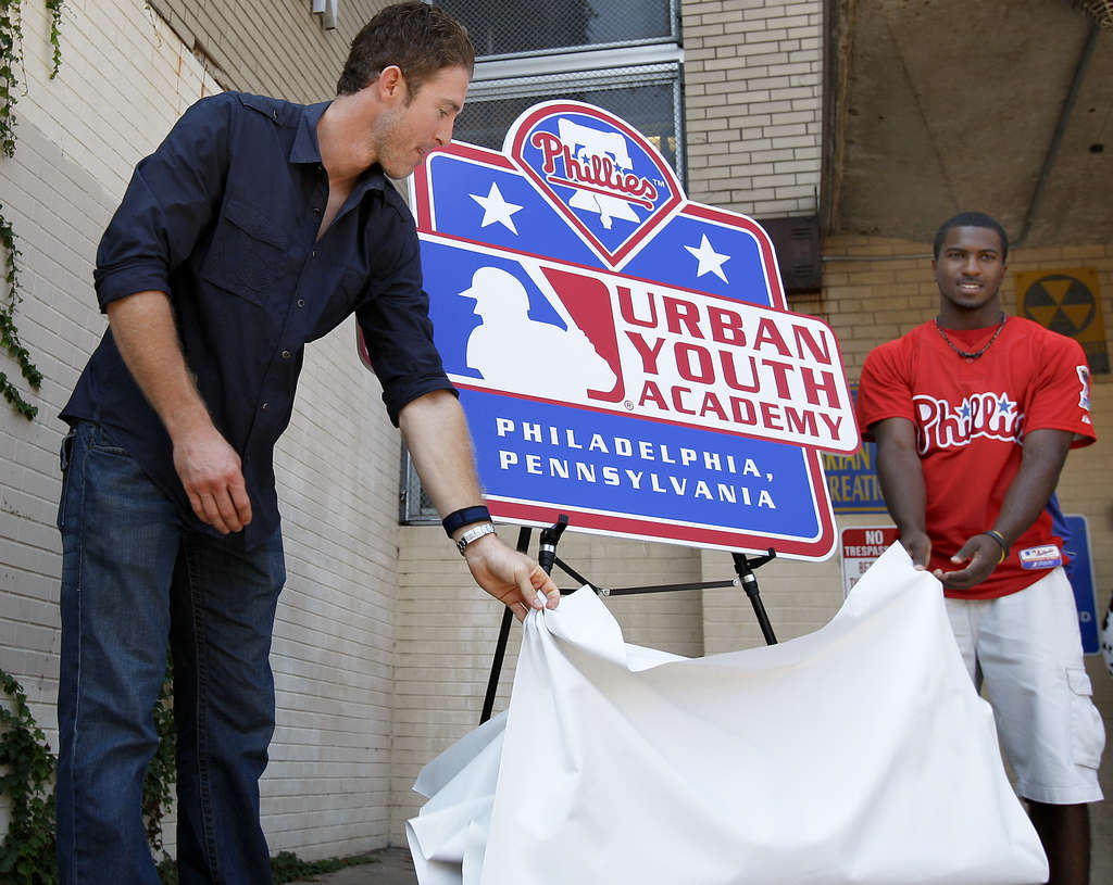 DAVID MAIALETTI / STAFF PHOTOGRAPHER The Phillies´ Chase Utley (left) and Demetrius Jennings in 2010, unveiling a sign for the still-to-be-built academy, which may finally get under way this winter.