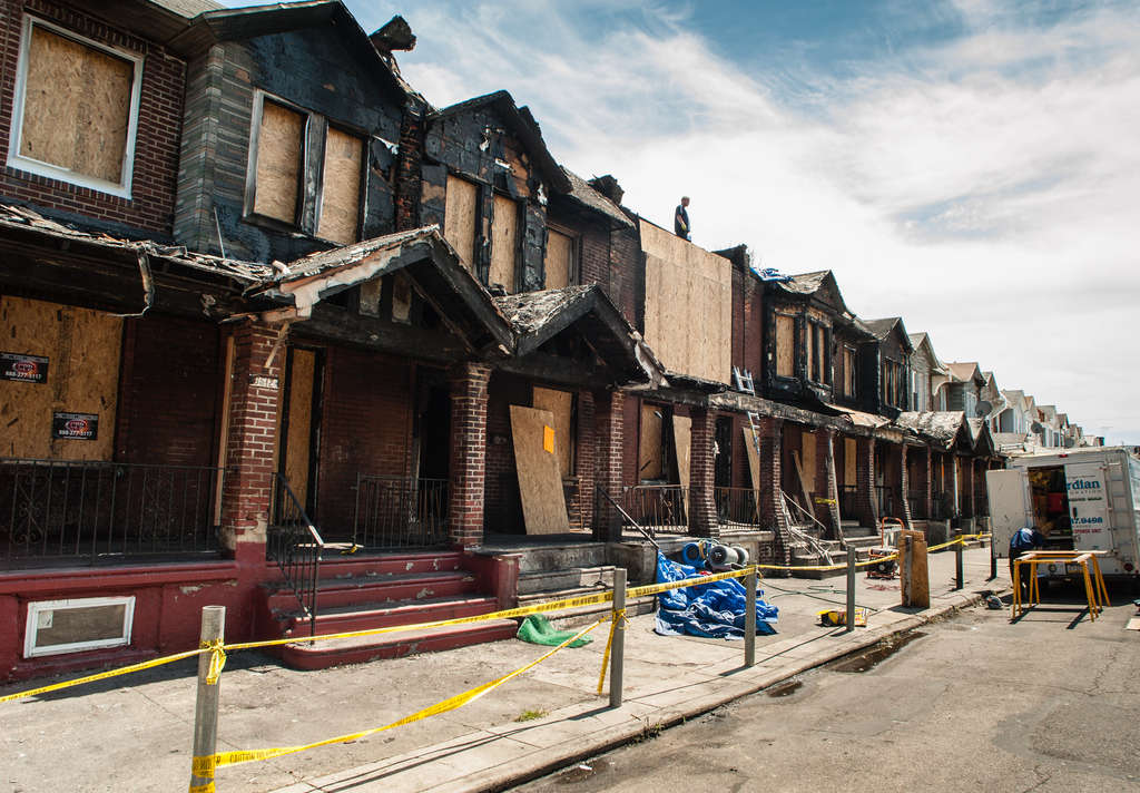 MATTHEW HALL / STAFF PHOTOGRAPHER A fire in July on Gesner Street in Southwest Philly damaged eight homes and killed four children.