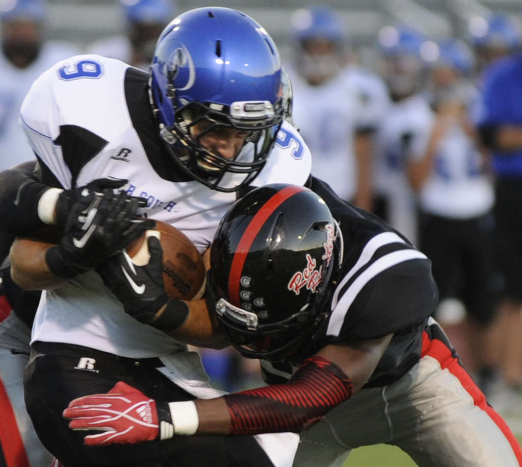 C.B. South´s Kevin Moran is tackled by Coatesville´s Jay Stocker in last year´s meeting. BRADLEY C. BOWER / For The Inquirer