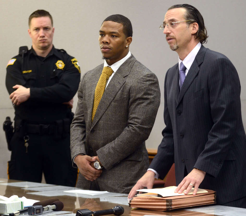 TOM GRALISH / STAFF PHOTOGRAPHER Ray Rice appears in court in May for his arraignment. His wife, Janay Palmer, is seated at the right in the rear.