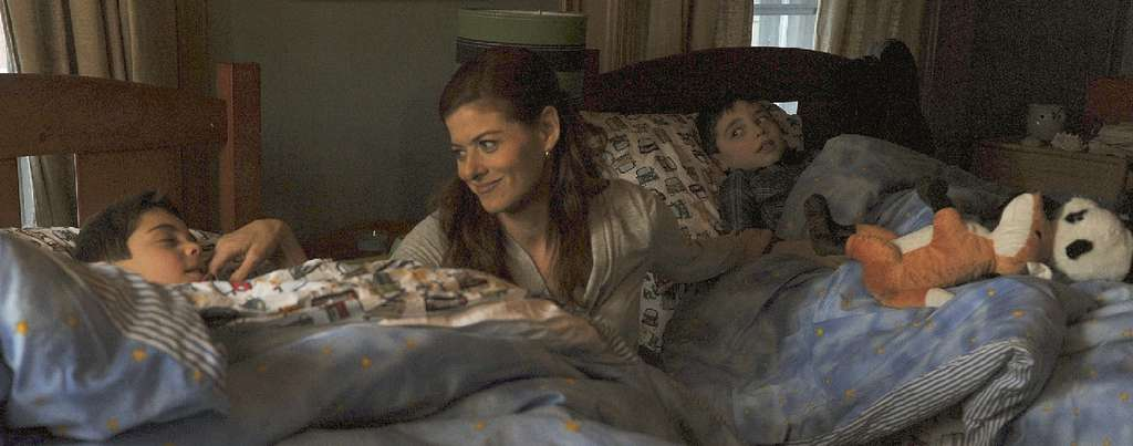 Debra Messing plays mom to twins Charlie Reina (left) and Vincent Reina.