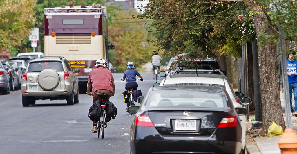 With no bike lane on 22d Street, bicyclists navigate traffic, parked cars.    DAVID M WARREN / Staff