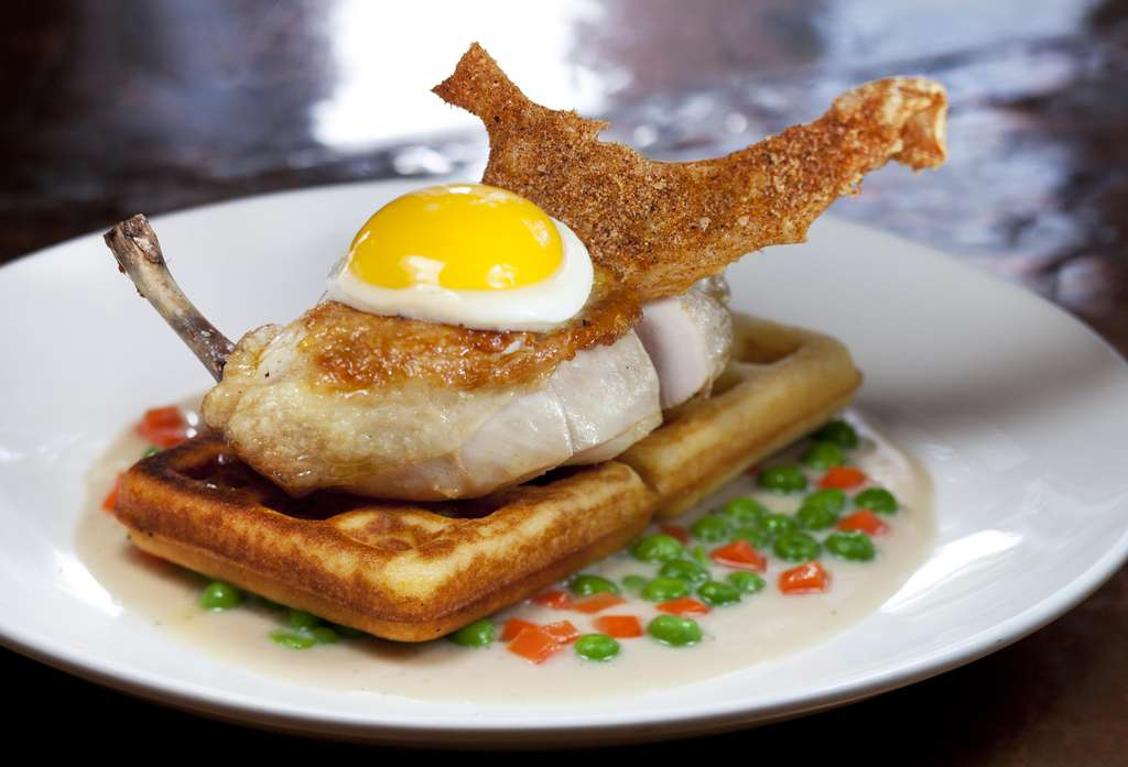 Chicken and waffles gets a revamp at Society Hill Society, topped with a fried egg.