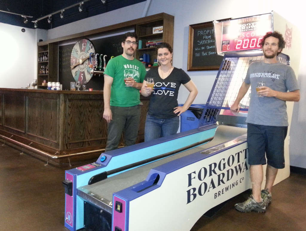 Come for the beer, stay for the Skee-Ball: At Forgotten Boardwalk Brewery, named for and given a taste of Asbury Park, the people responsible hoist a few at the Cherry Hill tasting room: brewer Dan Neuner (left), owner Jamie Queli (center) and head brewer David Bronstein.