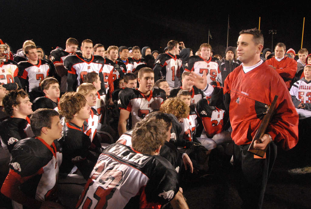 Haddonfield coach Frank DeLano holds the S.J. Group 2 trophy after 2010 win over W. Deptford. CURT HUDSON / For The Inquirer