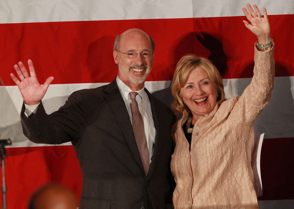 MICHAEL BRYANT / STAFF PHOTOGRAPHER Tom Wolf gets a boost from Hillary Clinton at the National Constitution Center yesterday.