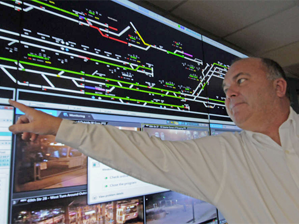 At SEPTA headquarters, Ronald Hopkins, assistant general manager of operations, at a screen showing rail operations in real time.