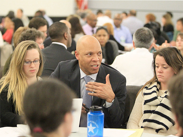 Philadelphia School Superintendent William R. Hite Jr. talks with one of the groups at Monday night´s meeting. ( CHARLES FOX / Staff Photographer )
