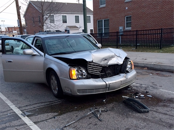 This grey sedan was damaged when detectives from the Police Department and the Attorney General´s Office crashed into it as they were chasing a gun-toting teen in South Philly. (Vinny Vella / Daily News)