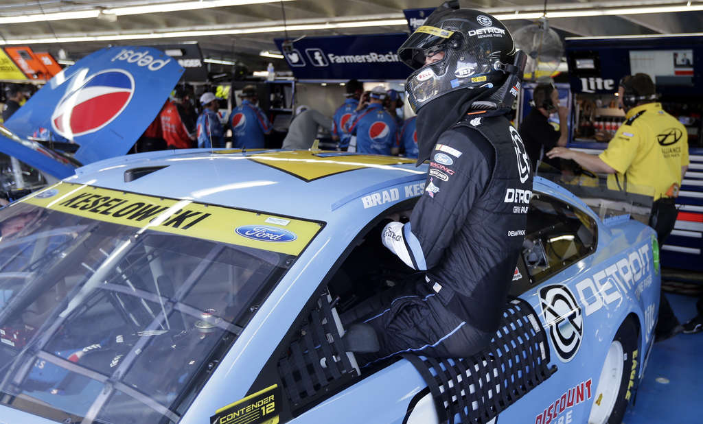 Associated Press Brad Keselowski climbins into his car before last weekend´s race at Charlotte, where he and other hotheaded drivers clashed.