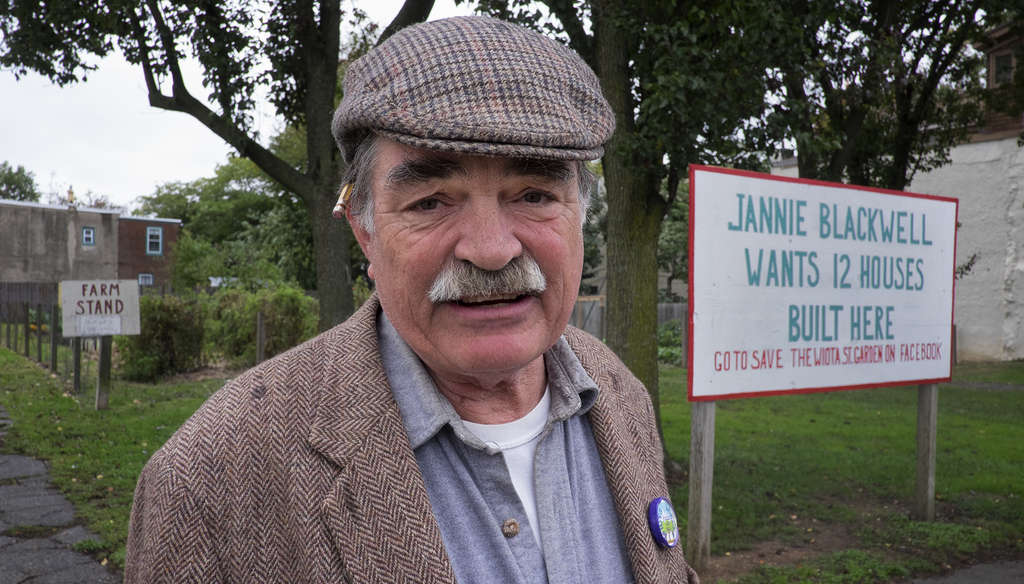 Activist John Lindsay at the Wiota Street Garden with his sign calling out Councilwoman Jannie Blackwell. The Philadelphia Redevelopment Authority says Blackwell´s decision will guide it.