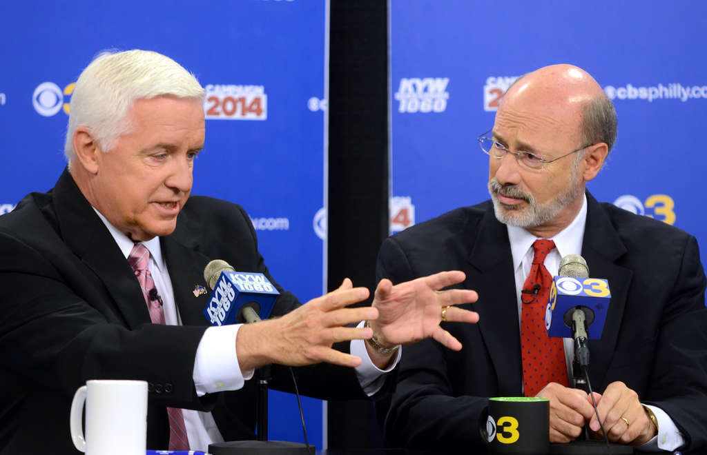 TOM GRALISH / STAFF PHOTOGRAPHER Gov. Corbett (left) says competitor Tom Wolf will raise taxes, but Wolf continues to lead polls.
