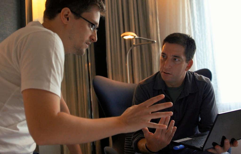 "Edward Snowden (left), Glenn Greenwald talking in Hong Kong in ""Citizenfour."""