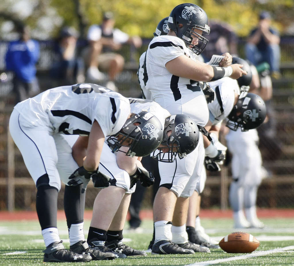 They´re not synchronizing their watches. Bishop Eustace offensive linemen look at their wrists to figure out the play in the team´s no-huddle system. ELIZABETH ROBERTSON / Staff