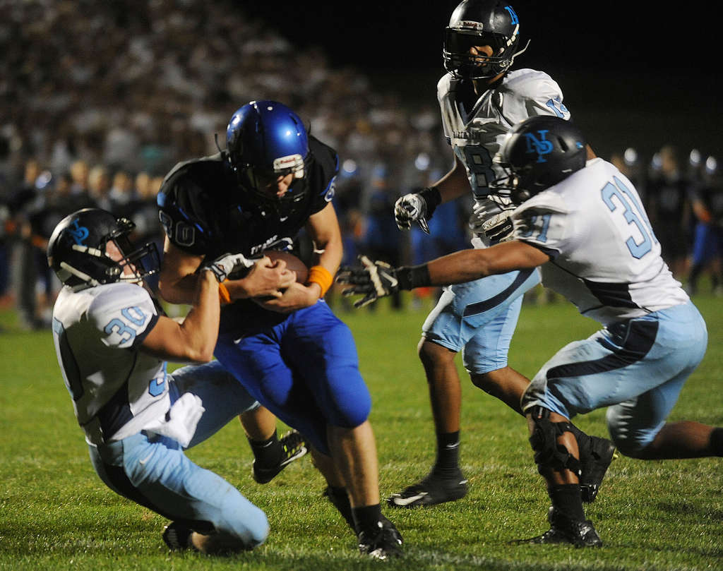 North Penn´s Justin Ostopowicz (left) and Dorian Sobetsky (right) can´t keep Central Bucks South´s Troy Robertson out of the end zone.