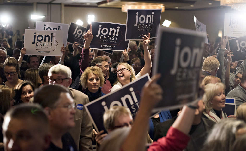 Backers attend an election night rally for Iowa Republican Joni Ernst, who won her Senate race by a bigger margin than models predicted.