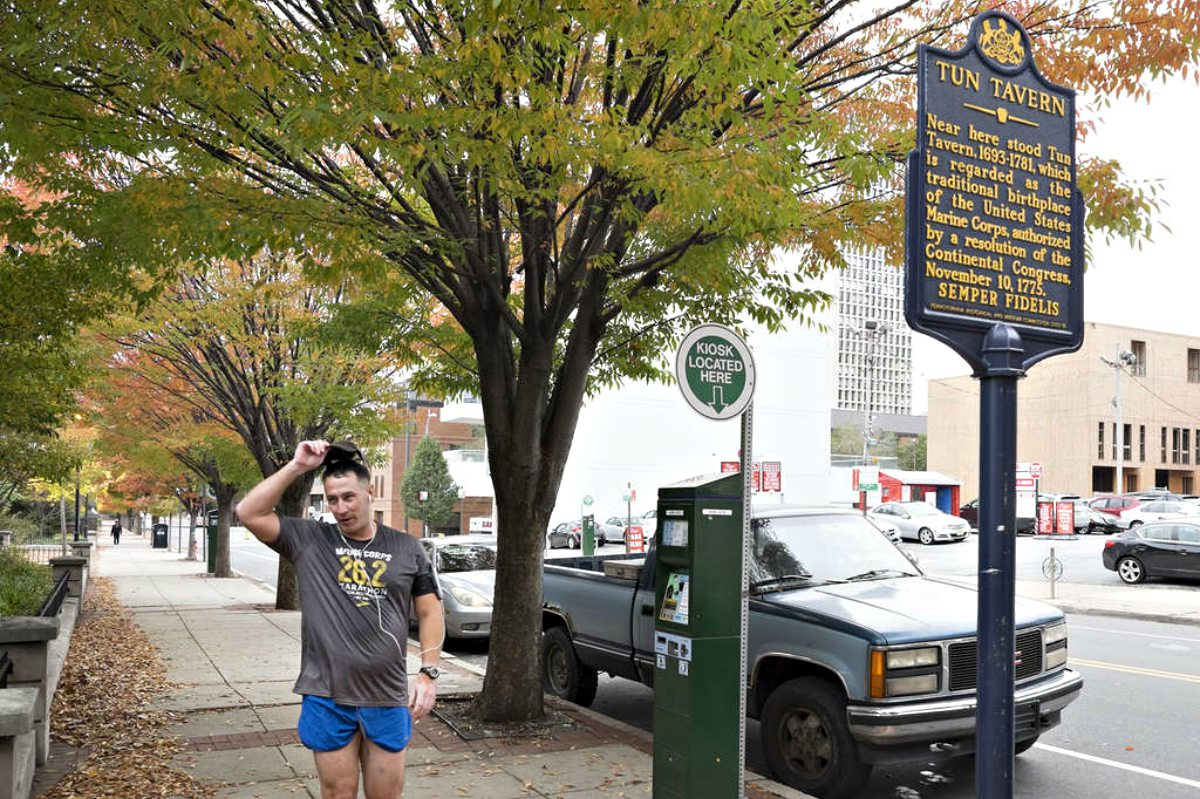 Capt. Jason Dequenne tips his hat at the site of the Tun Tavern, birthplace of the U.S. Marine Corps, on South Front Street in Society Hill.