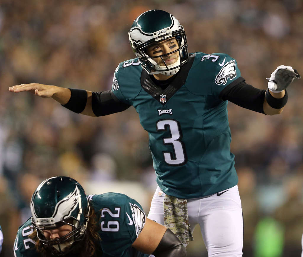 DAVID MAIALETTI / STAFF PHOTOGRAPHER Mark Sanchez tries to quiet the crowd during the first quarter against Carolina.