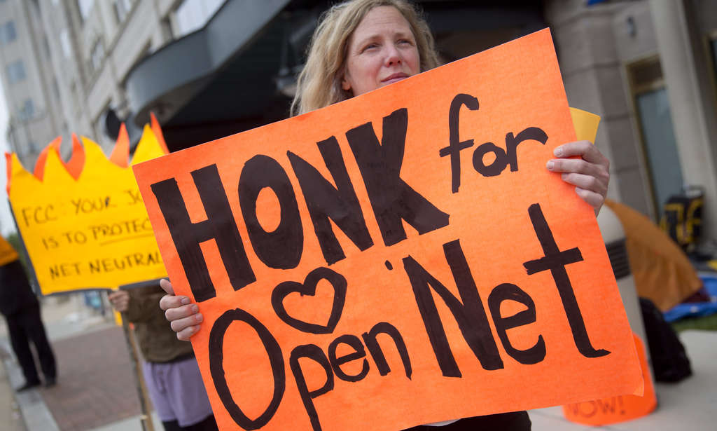 A demonstrator supporting net neutrality outside FCC offices in Washington. Last week, President Obama urged the commission to act.