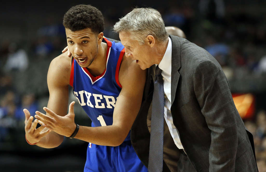 Michael Carter-Williams and coach Brett Brown talk during the Sixers 123-70 loss to Dallas.