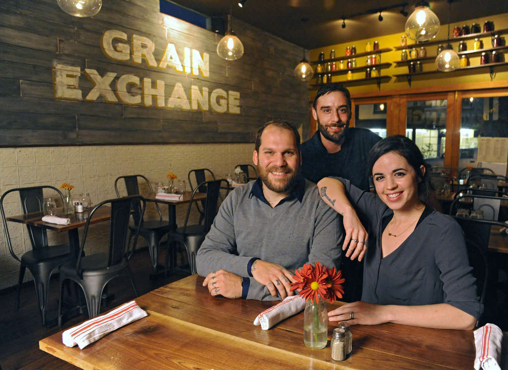 Jessica and Marvin Graaf (seated), owners of the Cresheim Valley Grain Exchange restaurant, 7152 Germantown Ave., with their chef, Trevor Elliott.