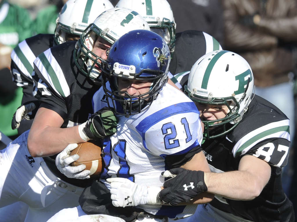 Quakertown running back Rob Burns is tackled by a host of Pennridge players during the first quarter of last year´s Thanksgiving Day matchup.