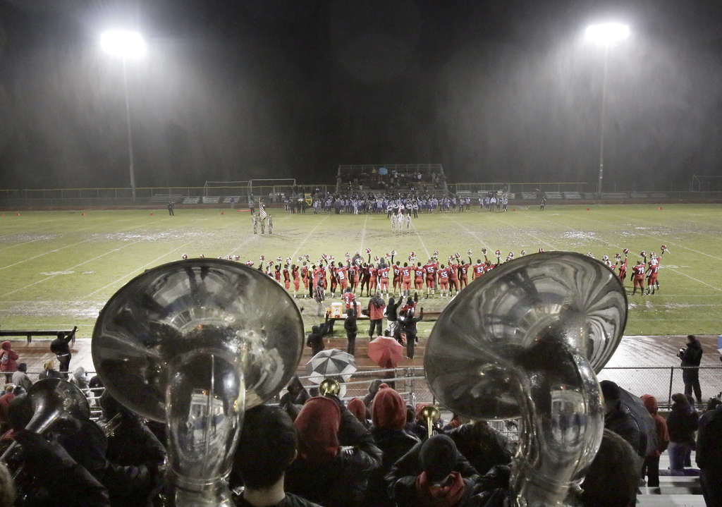 Cherry Hill East´s band performs the national anthem before Wednesday´s renewal of the football rivalry with C.H. West. ELIZABETH ROBERTSON / Staff