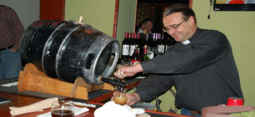 The Rev. Kirk Berlenbach of St. Timothy´s Episcopal taps the first keg of Gingerbread Jesus at Barren Hill Tavern in Lafayette Hill.