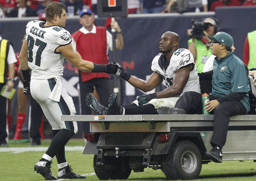 Carted off the field on Nov. 2, DeMeco Ryans got support from teammate Brent Celek. The linebacker suffered an Achilles injury that ended his season. RON CORTES / Staff Photographer