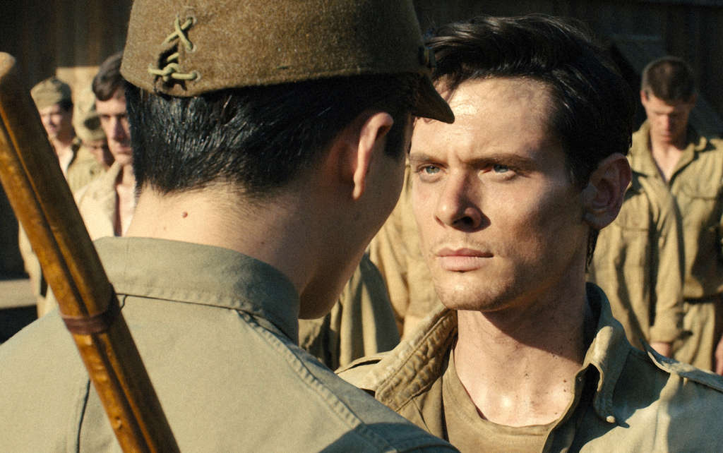 """Jack O´Connell as Olympic runner and war hero Louis Zamperini in """"Unbroken."""""""