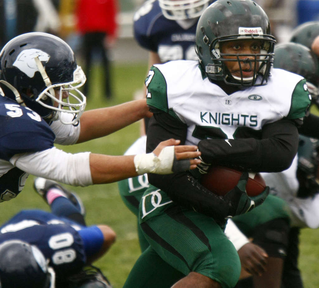 Delco Christian running back Nazim Trammell-Wells , the small-schools player of the year, led the Knights to the District 1 Class A championship. LOU RABITO / Staff