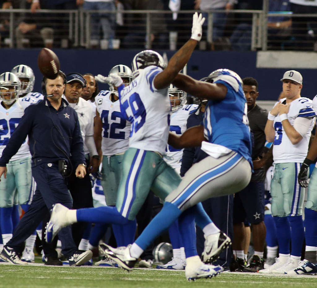 ASSOCIATED PRESS Cowboys´ Anthony Hitchens is hit in the back by a pass intended for Lions´ Brandon Pettigrew. The officials threw a flag on the play but then reversed the call.