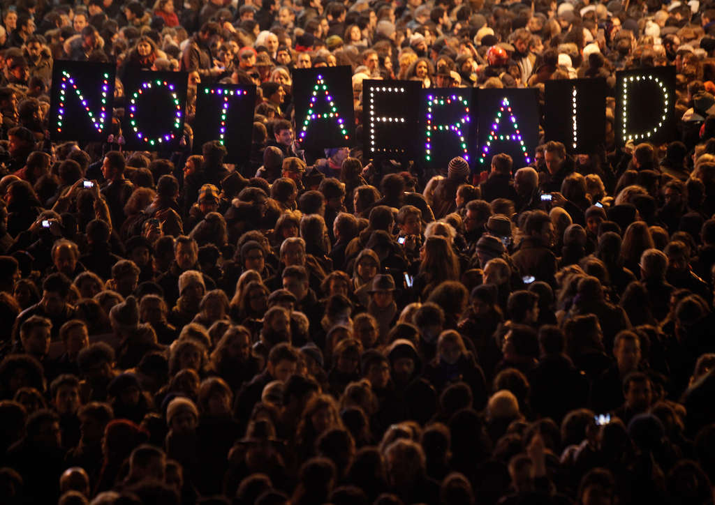 People gathered Wednesday in solidarity with the victims of the terror attack against the satirical newspaper Charlie Hebdo.