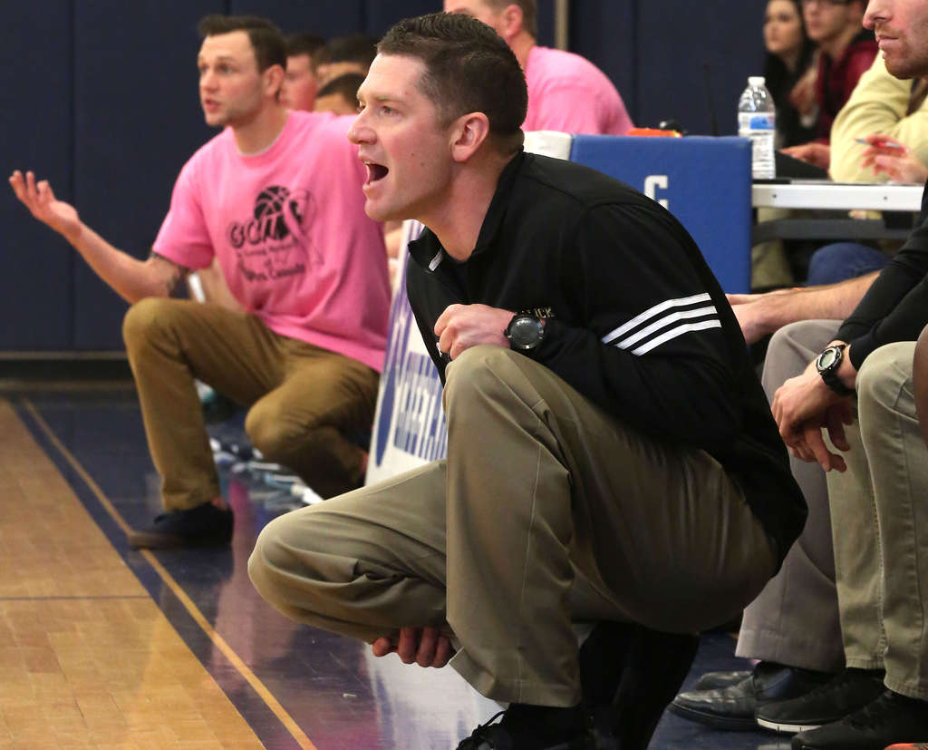 Schalick´s Eric Cassidy (right) coaches against his brother Josh (left) of GCIT in a Breast Cancer Awareness game. DAVID SWANSON / Staff