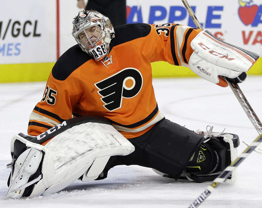 ASSOCIATED PRESS Flyers goalie Steve Mason grimaces in pain after suffering injury Saturday against Boston.