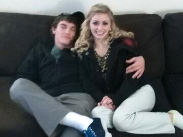 In this December 2014 photo provided by Tammy Martin, her son Dalton Hayes poses with his girlfriend Cheyenne Phillips at his family´s home in Leitchfield, Ky.