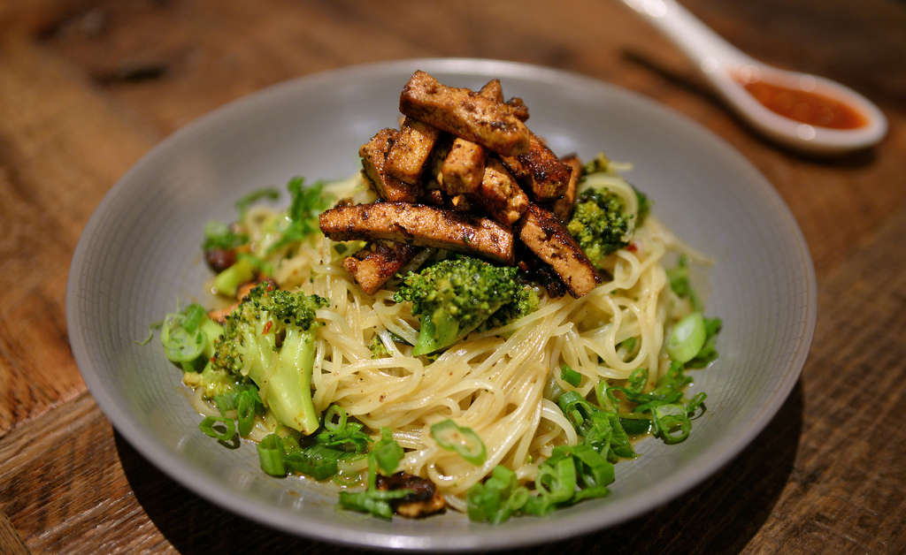 Singapore noodles with char siu tofu, broccoli, peanuts, and lime sambal. Global influences on V Street´s concise, coherent vegan menu - just 13 savory items - include Hungarian, Peruvian, and Korean. (TOM GRALISH / Staff Photographer)