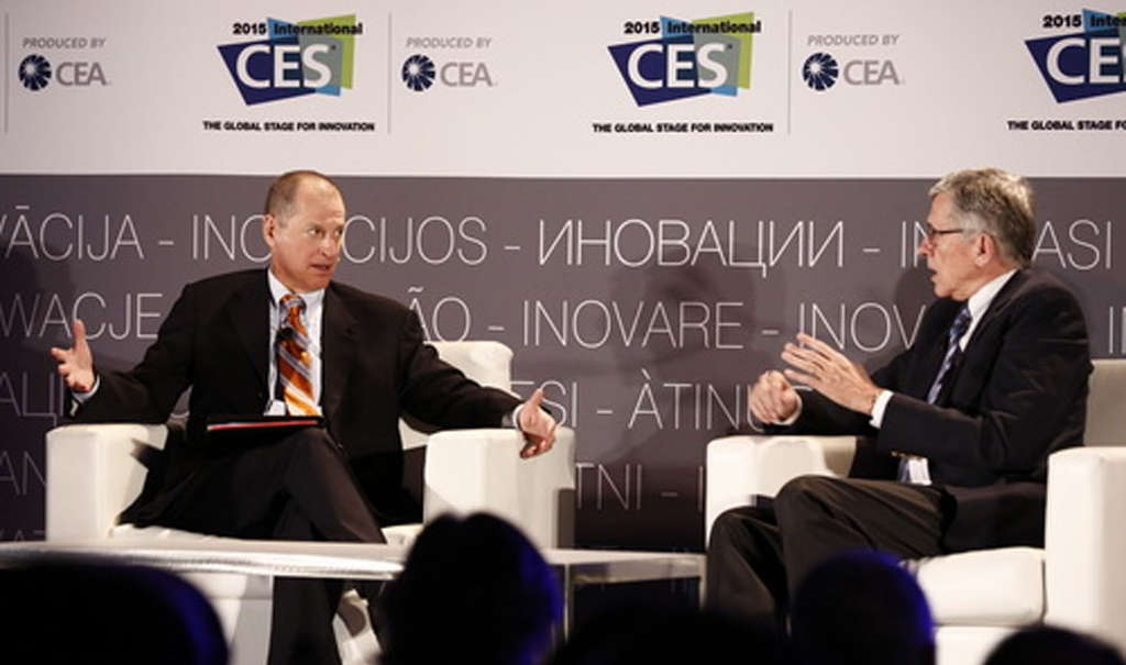 FCC Chairman Tom Wheeler (right) speaks with Gary Shapiro, head of the Consumer Electronics Association, at the Las Vegas electronics show.