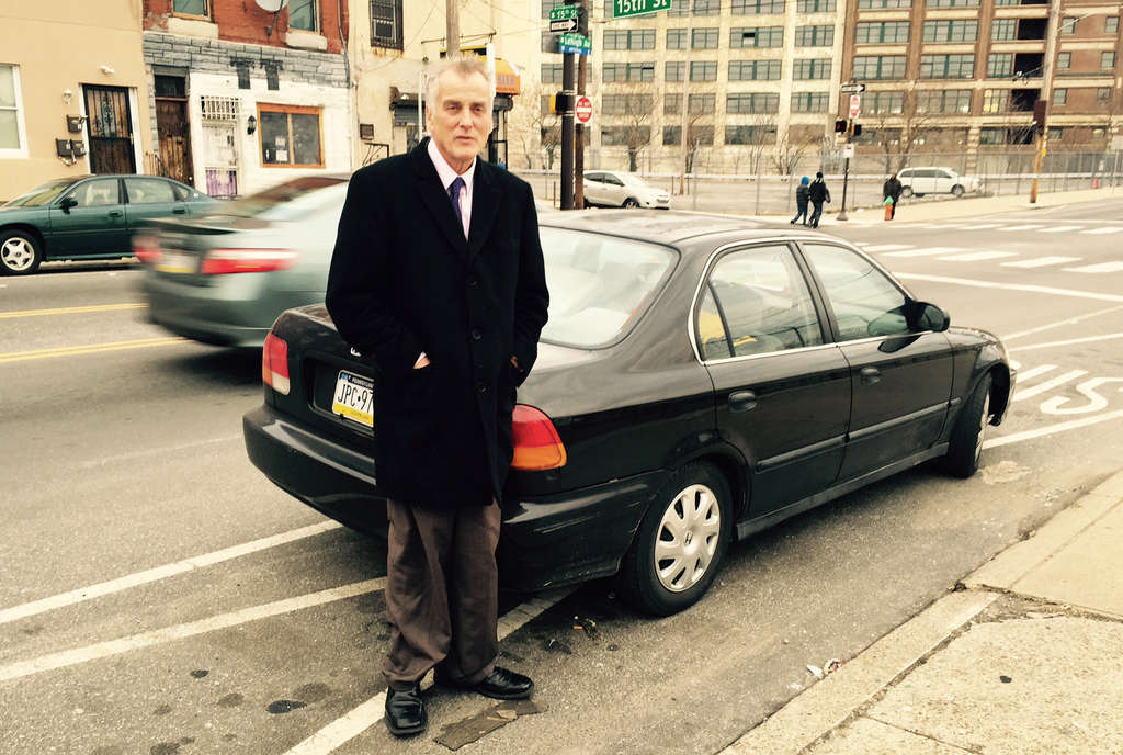 RONNIE POLANECZKY / DAILY NEWS STAFF Don Tollefson stands by his Honda Civic near the home in North Philly where a Good Samaritan has let him stay, rent free, in a spare room.