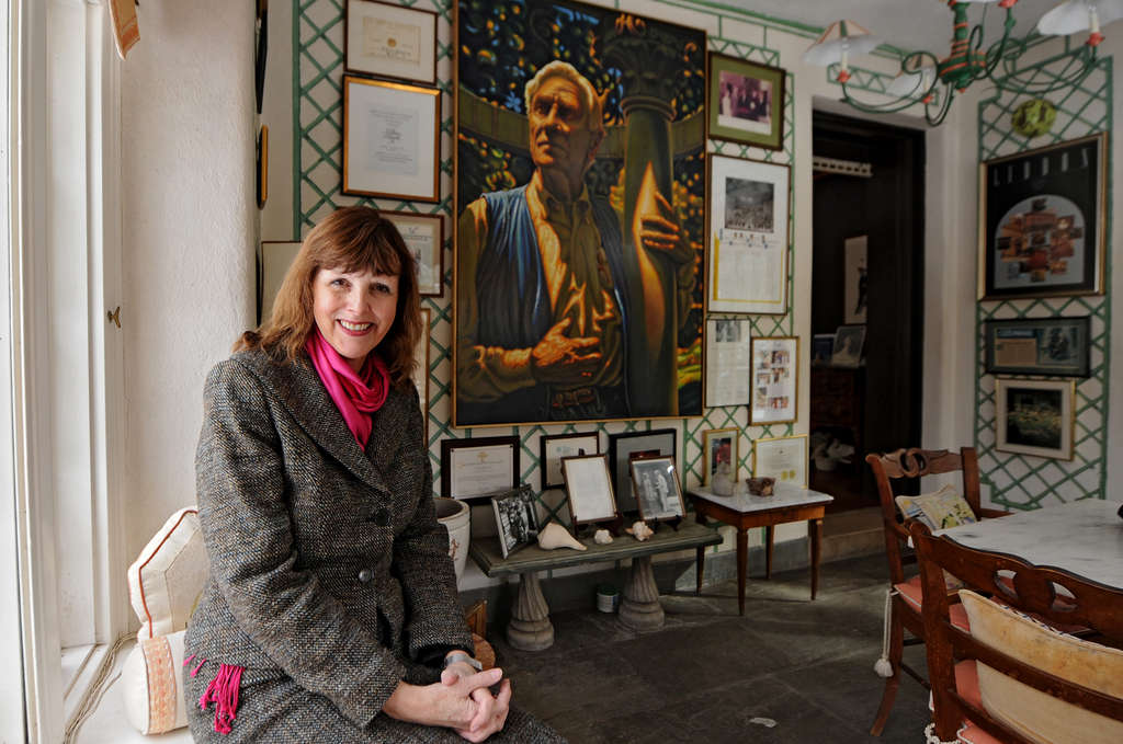 Jenny Rose Carey, new director of Meadowbrook Farm, in the manor house, with a portrait of PHS´s benefactor.