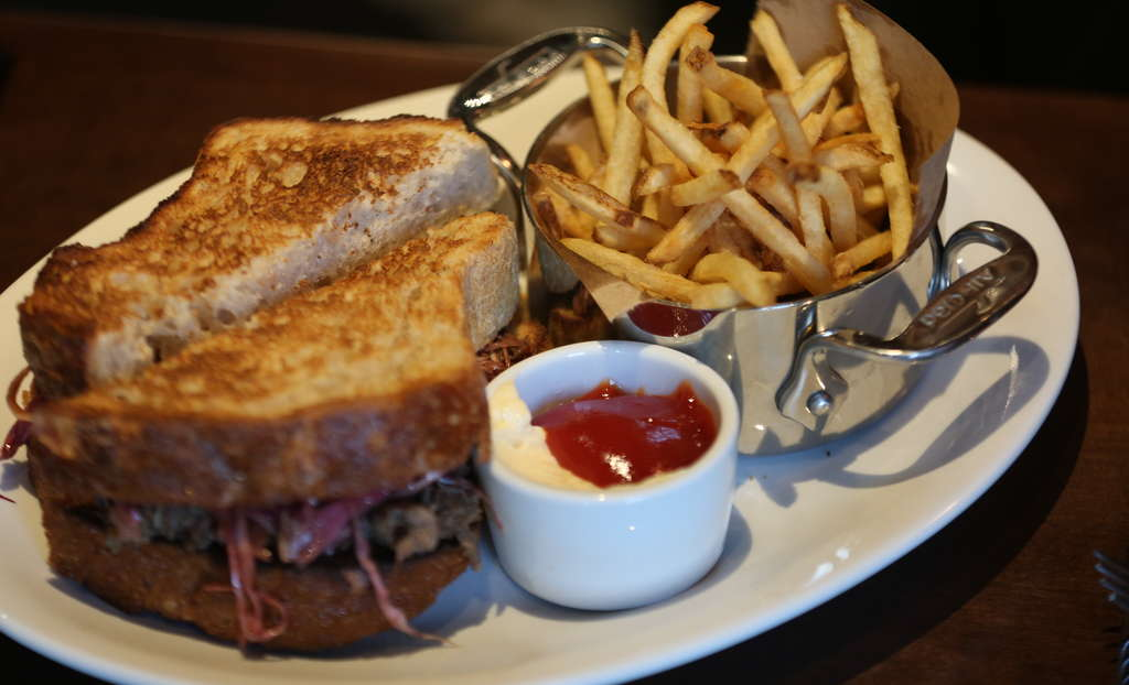 The spice-rubbed brisket sandwich is superbly rendered, moist and infused with smoke.