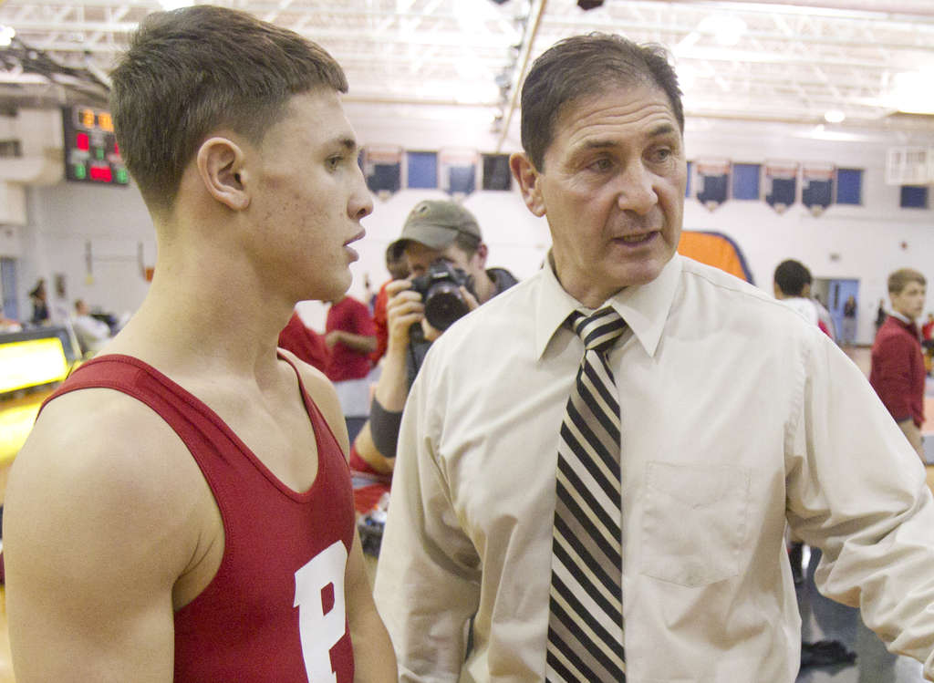 Paulsboro´s Paul Morina with son Sam, who helped clinch his father´s record-setting win. CHARLES FOX / Staff