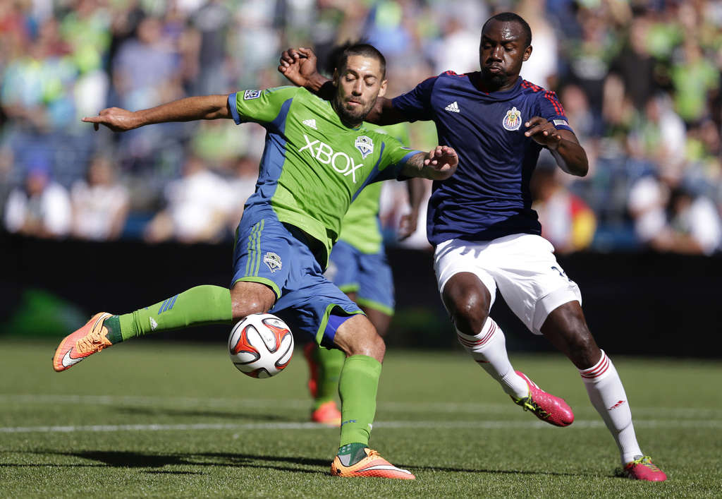 ASSOCIATED PRESS Clint Dempsey (left) departed the English Premier League in 2013 to play for Seattle, of the MLS.