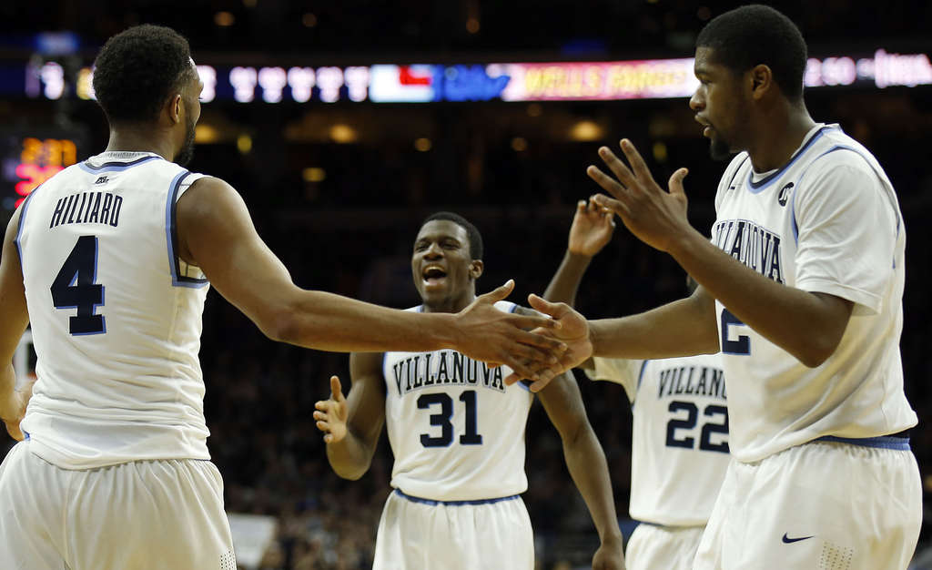 YONG KIM / STAFF PHOTOGRAPHER Villanova´s Darrun Hilliard celebrates with teammates after a three-point play against Georgetown.