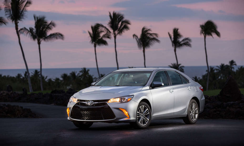 Toyota is promoting a sportier look and better handling in the 2015 Camry, A base Camry starts at $22,970, a base hybrid at $27,995.