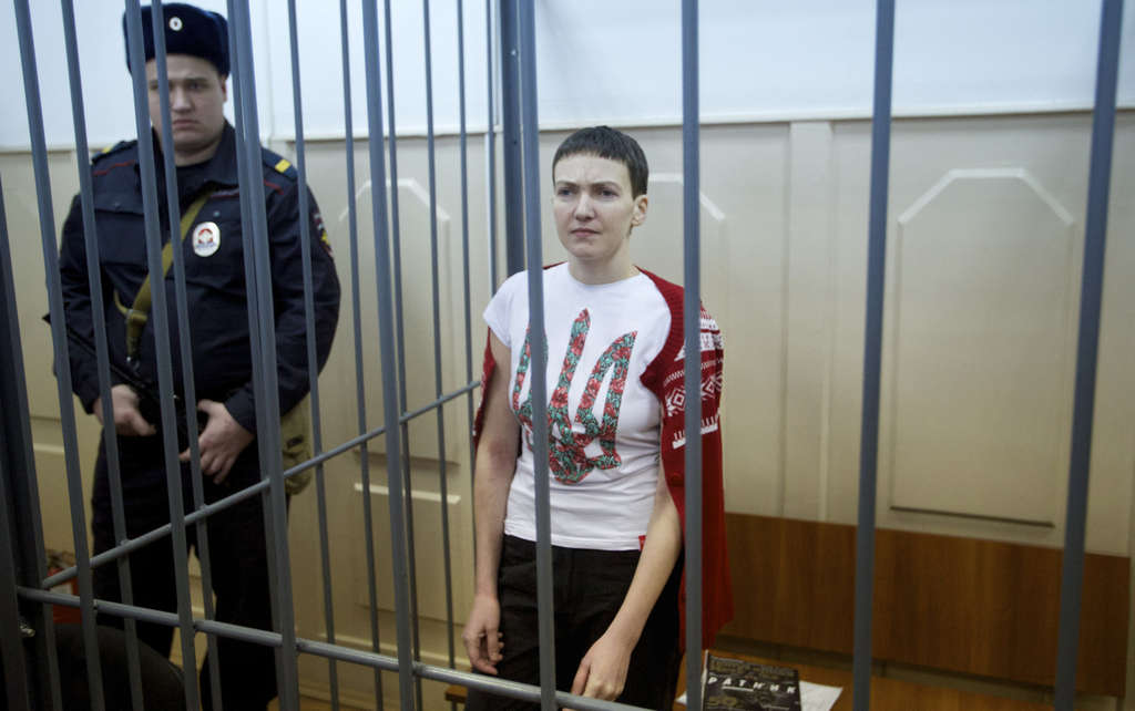 Unkrainian pilot Nadiya Savchenko stands in a cage in a courtroom in Moscow on Feb. 10. She has been on a hunger strike for more than 70 days.